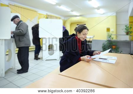MOSCOW - DECEMBER 4: People casting ballots on elections to State Duma of Russian Federation on December 4, 2011 in Moscow, Russia.