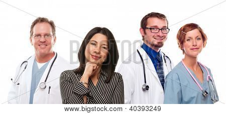 Attractive Hispanic Woman with Male and Female Doctors or Nurses Isolated on a White Background.