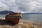image of tierra  - Boat run aground in a beach at fagnano lake tierra del fuego Argentina - JPG