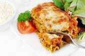 picture of lasagna  - Spinach lasagna with salad on a white plate - JPG