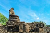 stock photo of beheaded  - Buddha statue without headin Candi Sewu complex  - JPG