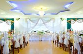 picture of wedding feast  - a restaurant banquet room decorated for a wedding party - JPG