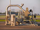 stock photo of lng  - Modern natural gas well detail during sunset - JPG