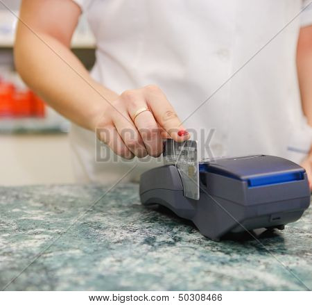 Close Up Of Human Hand Putting Credit Card Into Payment Machine