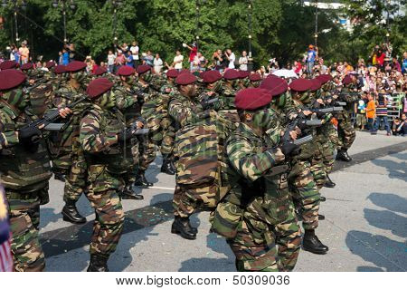 KUALA LUMPUR - AUGUST 31: Paratroopers in maroon beret from the 10th Airborne Brigade march on the city streets celebrating Malaysia's Independence Day on August 31, 2013 in Kuala Lumpur, Malaysia.
