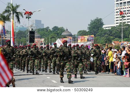 KUALA LUMPUR - AUGUST 31: Paratroopers from the 10th Airborne Brigade parade on the city streets celebrating Malaysia's Independence Day on August 31, 2013 in Kuala Lumpur, Malaysia.