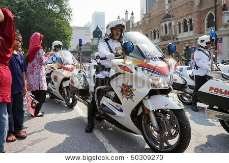 KUALA LUMPUR - AUGUST 31: Police outriders in super bikes parade on the city streets as they celebrate Malaysia's Independence Day (Hari Kemerdekaan) on August 31, 2013 in Kuala Lumpur, Malaysia.