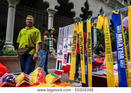 KUALA LUMPUR - AUGUST 31: A street vendor sells scarfs and other Malaysian memorabilia celebrating Malaysia's Independence Day (Hari Kemerdekaan) on August 31, 2013 in Kuala Lumpur, Malaysia.