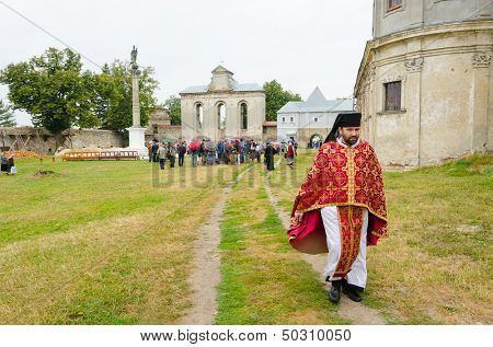 PIDKAMIN (PODKAMIEN), UKRAINE - AUGUST 14: unidentified priest of Ukrainian Greek Catholic Studite Brethren church in ruins of former Dominican Monastery, Pidkamin, Ukraine on august 14, 2013