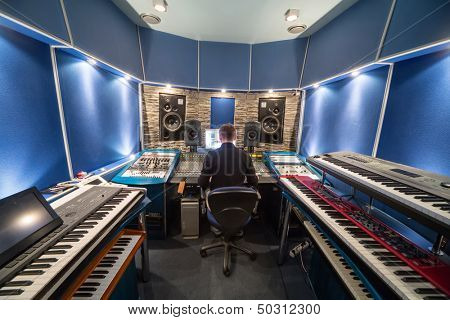 MOSCOW - DEC 25: Man in control room with music equipment in Recording Studio Nautilus on December 25, 2012 in Moscow, Russia.