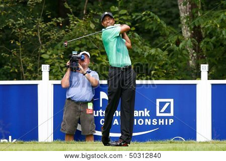 NORTON, MA-SEP 1: Tiger Woods tees off the fifth hole during the third round at the Deutsche Bank Championship at TPC Boston on September 1, 2013 in Norton, Massachusetts.