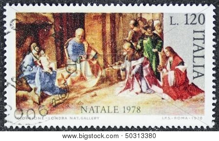 ITALY - CIRCA 1978: a stamp printed in Italy celebrates Christmas showing a nativity scene. Italy, circa 1978