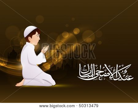 Young Muslim guy in traditional outfits on shiny abstract background with Arabic Islamic calligraphy of text Eid Al Azha or Eid Al  Adha.
