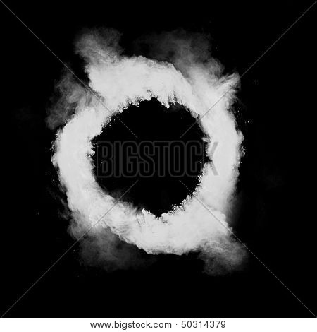 Freeze motion of white dust in round shape isolated on black background