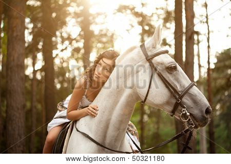 Beautiful woman on a horse. Horseback rider, woman riding horse