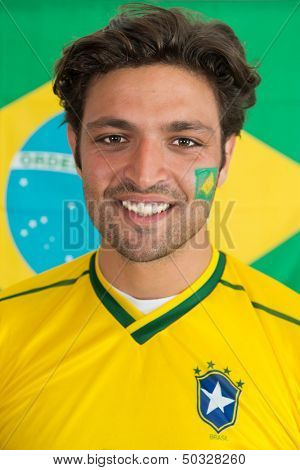 Confident, snug looking man in the colours of the National Brazilian soccer team