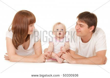 Happy family, mother, father and daughter lying on the white background