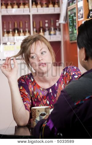 Bored Woman In Coffee House With Male Friend
