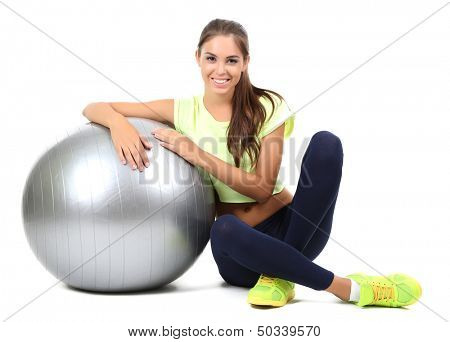 Young beautiful fitness girl with grey ball isolated on white