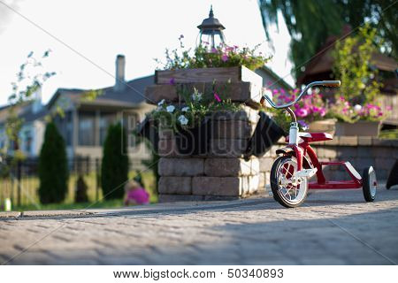 Childs Red Tricycle On A Patio