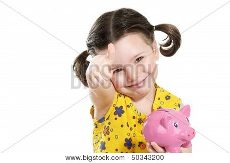 Beautiful Happy Baby Girl Holding A Pretty Piggybank
