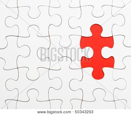 Incomplete puzzle with missing piece