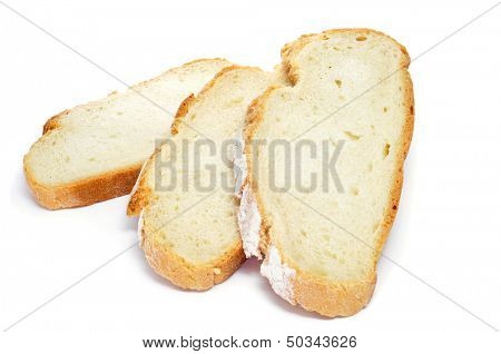some slices of pan de payes, a round bread typical of Catalonia, Spain, on a white background