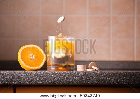 Vitamin C healthy lifestyle concept �¢?? orange, tablet stack, dissolving tablet