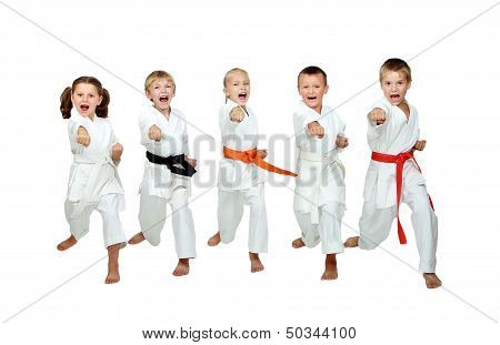 In the kimono little kids beat a karate kick arm