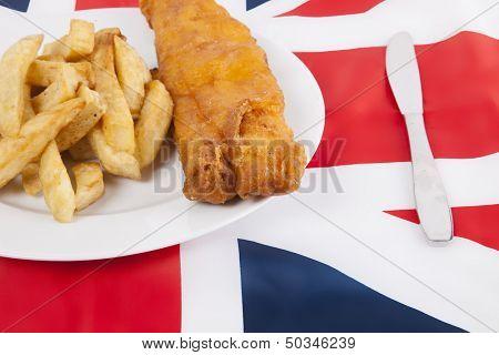 Cropped shot of junk food over British flag
