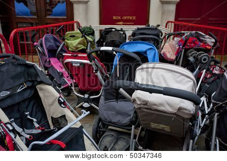 Group of prams or strollers outside theater
