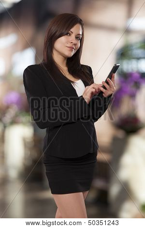 Young Woman Looks Up From Her Phone While Texting.