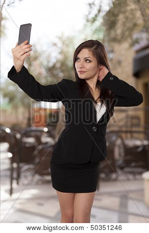 Young Professional Looking Woman Takes A Self Portrait With Her Phone.