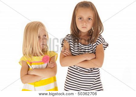 Two Young Sisters Angry At Each Other Younger One Glancing Up At Her Older Sister