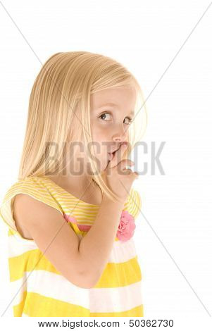 Cute Blonde Girl With Hand Up To Lips Shushing