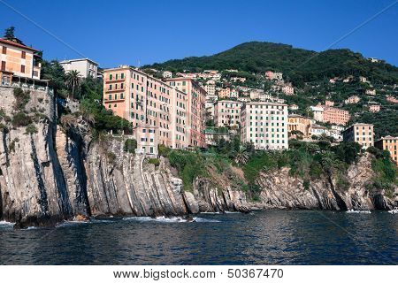 Houses Built On The Rocks Overhanging Sea