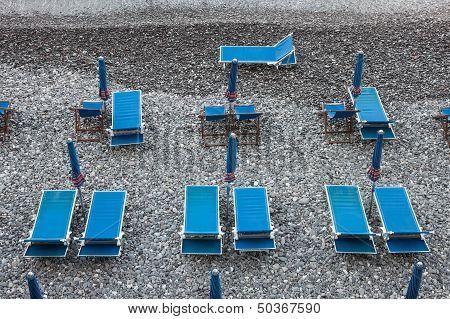 Blue Deckchairs On Stony Beach in Camogli