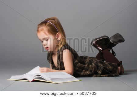 Girl Lying And Reading.