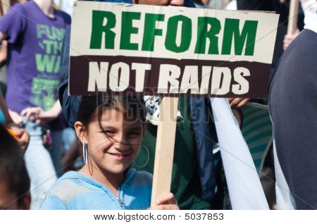 Latina Girl With Sign: Reform, Not Raids