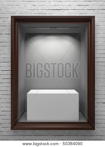 wooden showcase with white stand and frame