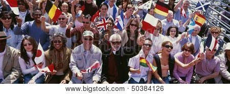 Happy group of people waving flags of different countries