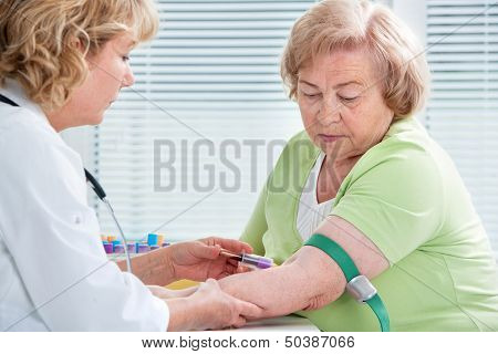 Nurse Taking Blood Sample