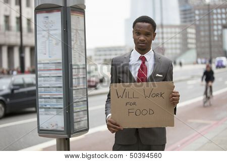 Young businessman holding