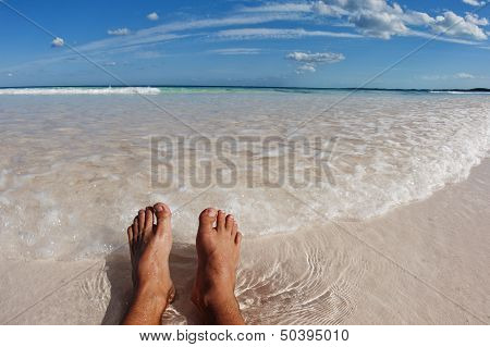 Feet on idyllic beach