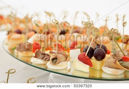 Various meat, fish and cheese banquet snacks on banquet platter