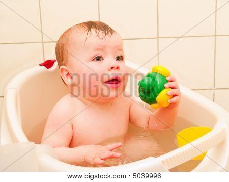 Cute Baby Boy Enjoying A Bath With Copyspace