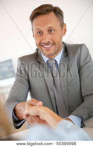 Man shaking hand to job applicant after interview