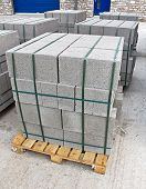 image of cinder block  - Pallets of breeze blocks at a construction site from a builders merchant known as cinder blocks in the us or Concrete masonry units - JPG
