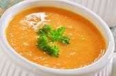 pic of ribs  - Creamy carrot and sweet potato soup with parley garnish in white ribbed soup bowl - JPG