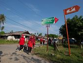 PADANG - AUGUST 25: Villagers return home after marketing in Padang, Sumatera, Indonesia on August 2